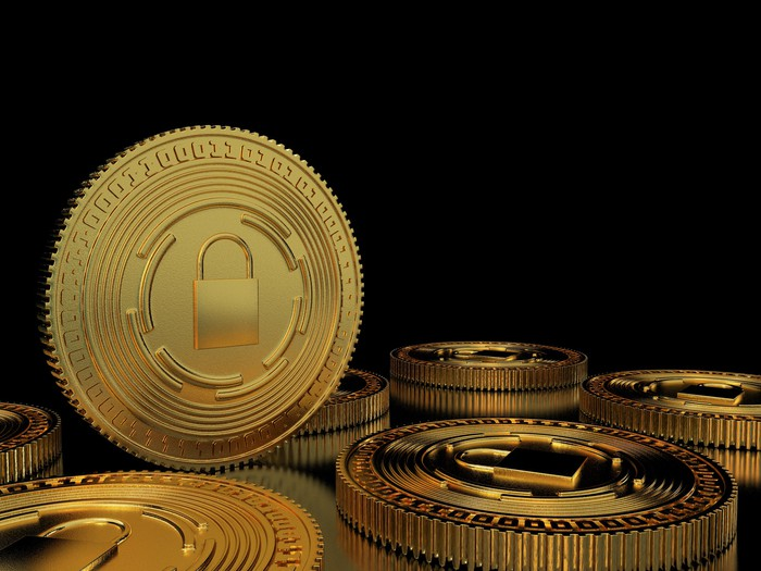 A rendering of gold coins with a lock in the middle of them.