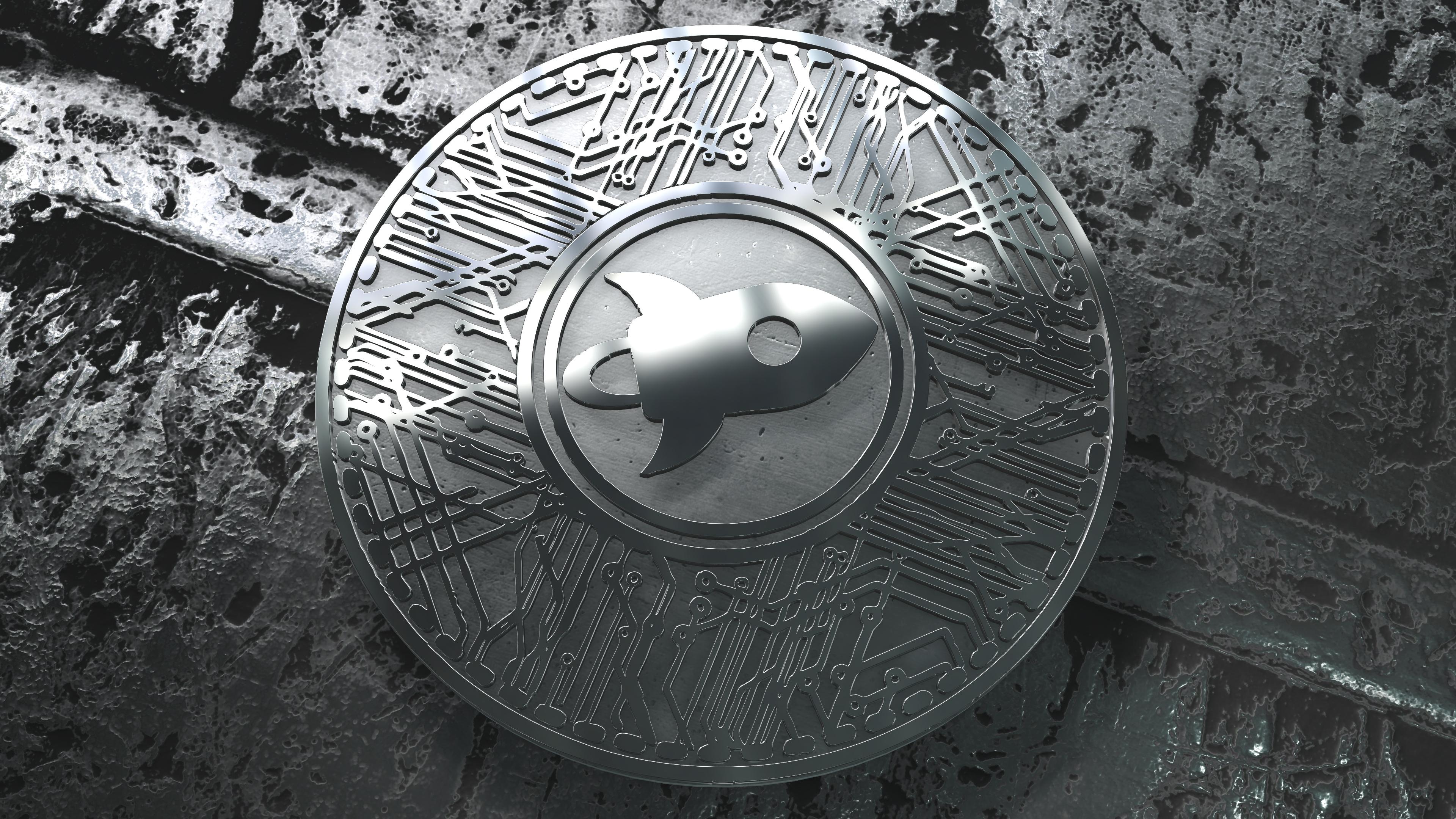 A physical silver Stellar Lumens coins.