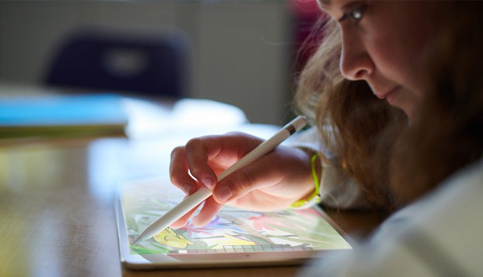 A girl using the new iPad and an Apple Pencil