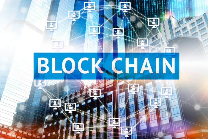 "The word ""Blockchain"" in front of abstract computer graphics"