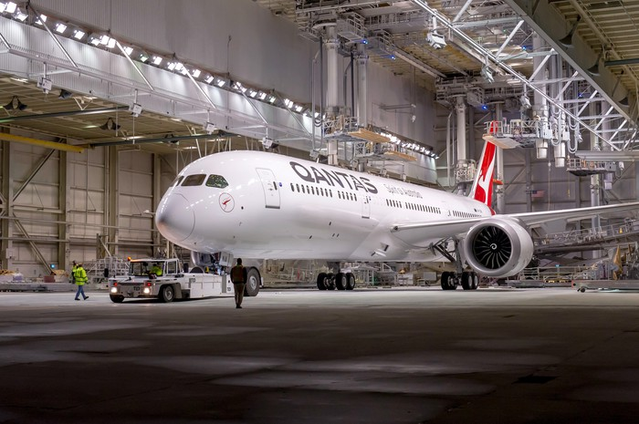 A Qantas 787-9 Dreamliner parked in a hangar