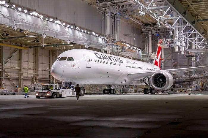 A Qantas 787-9 Dreamliner parked in a hangar