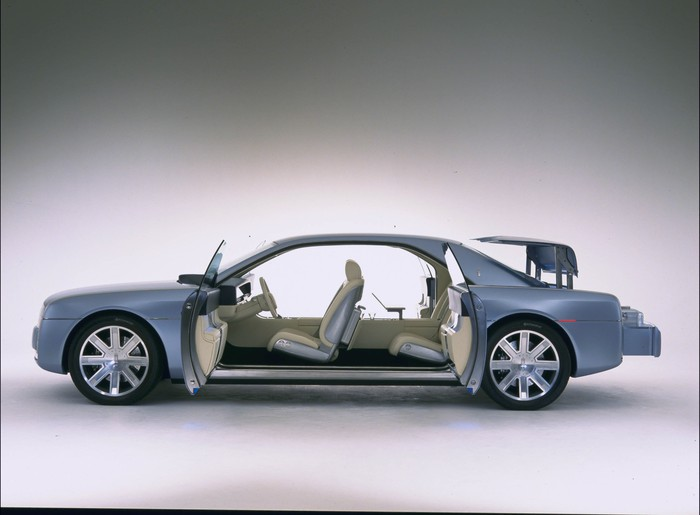 """The 2002 Lincoln Continental Concept, a show-car take on a large luxury sedan, with its doors open showing the """"suicide doors"""" in the rear."""