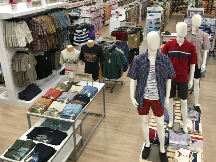 The sales floor at a Sears store with mannequins and boys clothes.