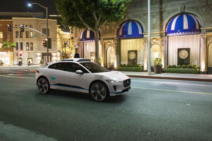 Jaguar car with Waymo self-driving sensors.