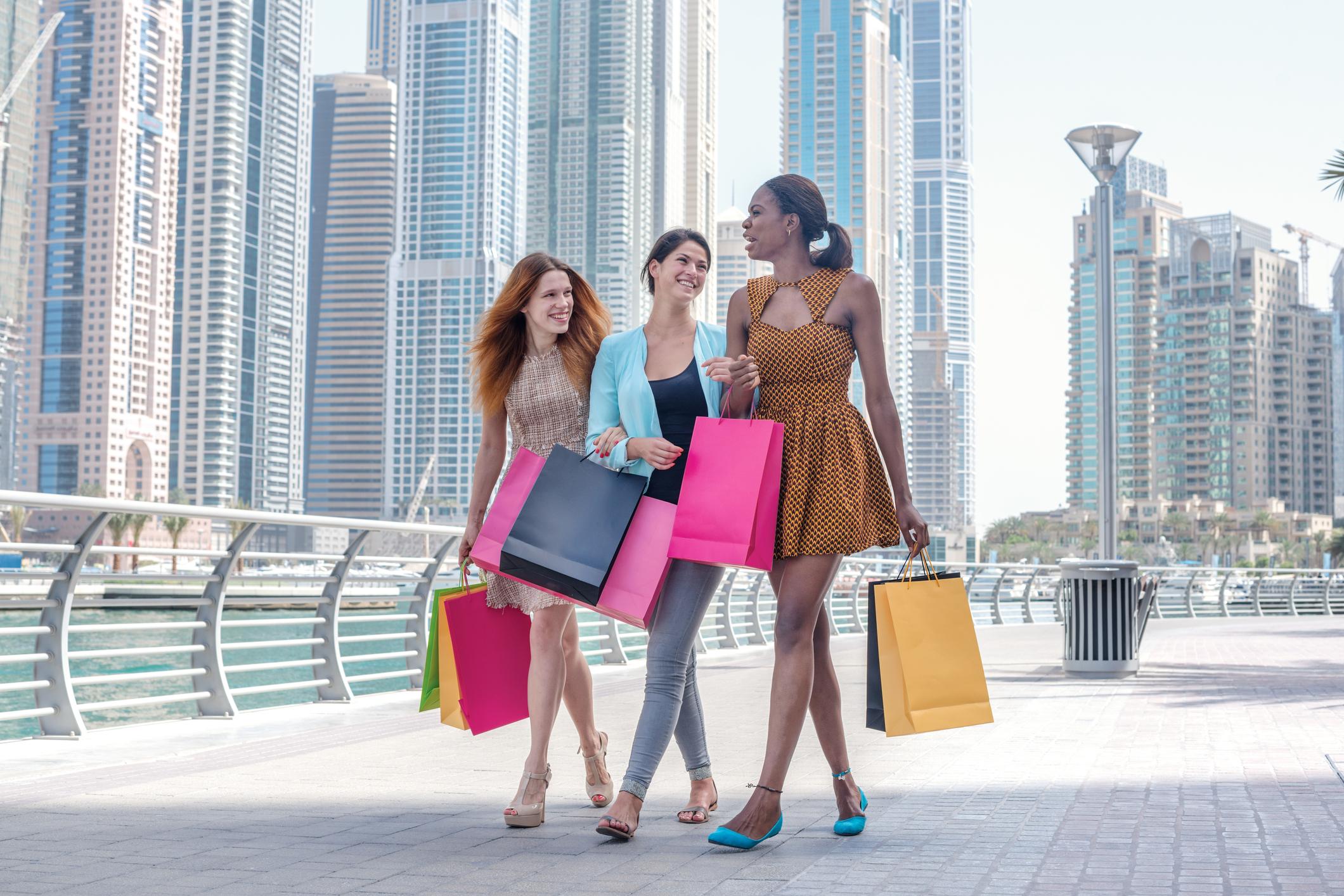 Three young women go shopping.