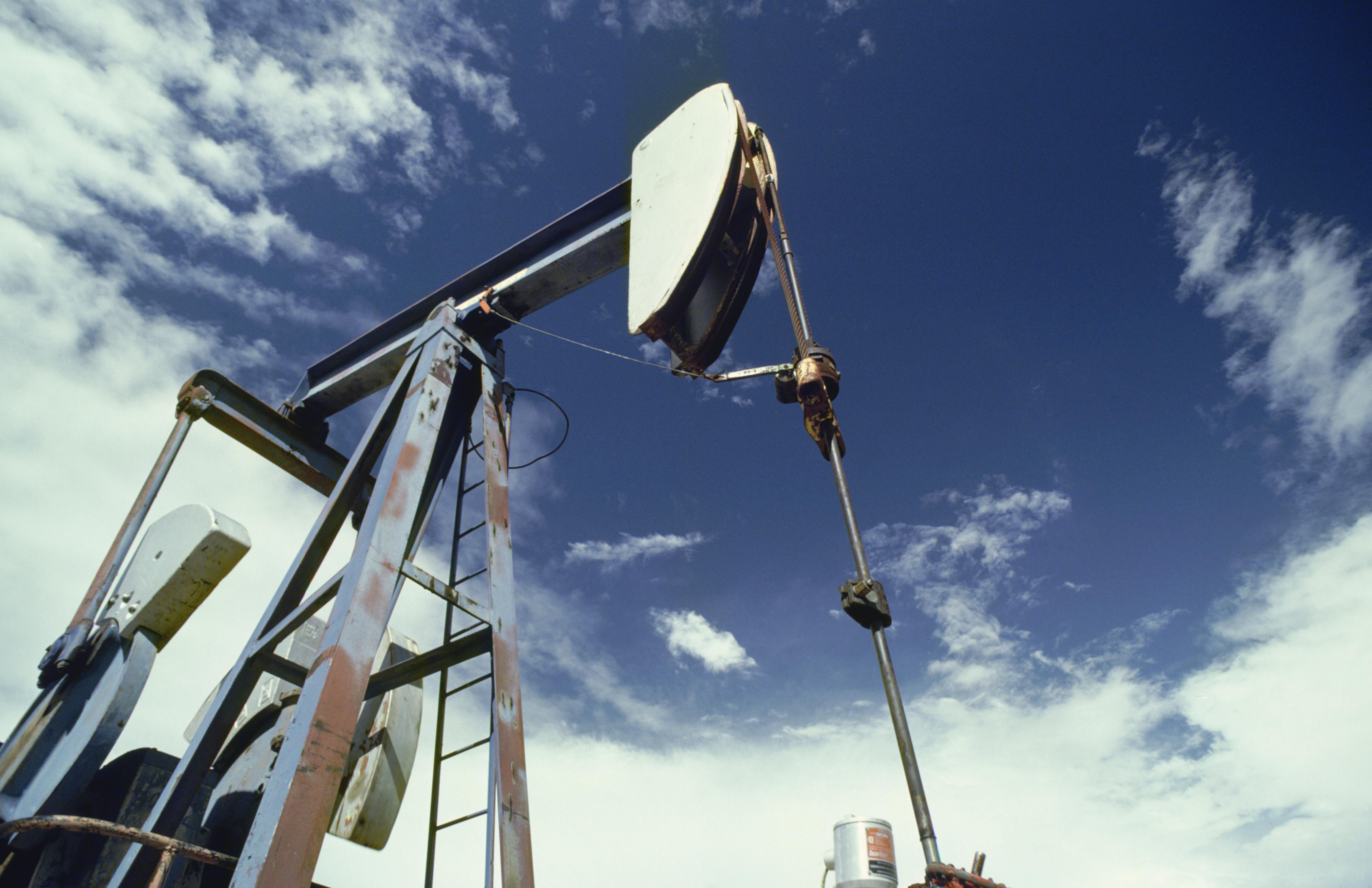 An oil pump with a blue sky above.