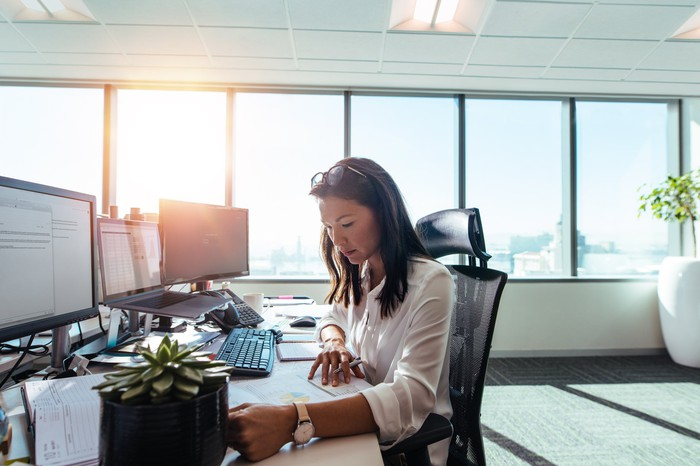 Woman working at a desk in an office