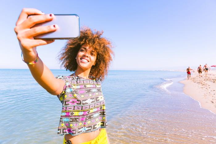 A woman takes a selfie.