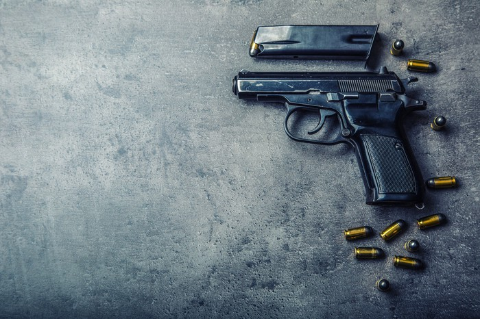 A 9mm pistol with bullets strewn around it