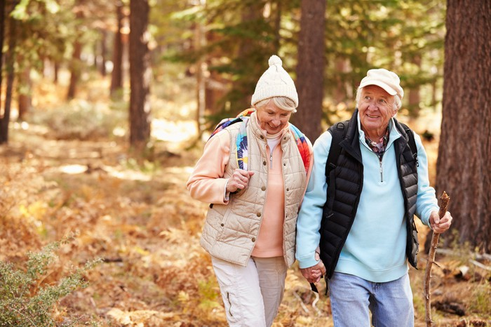 Senior couple hiking in the woods.