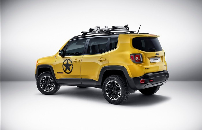Yellow Jeep vehicle in a white room.