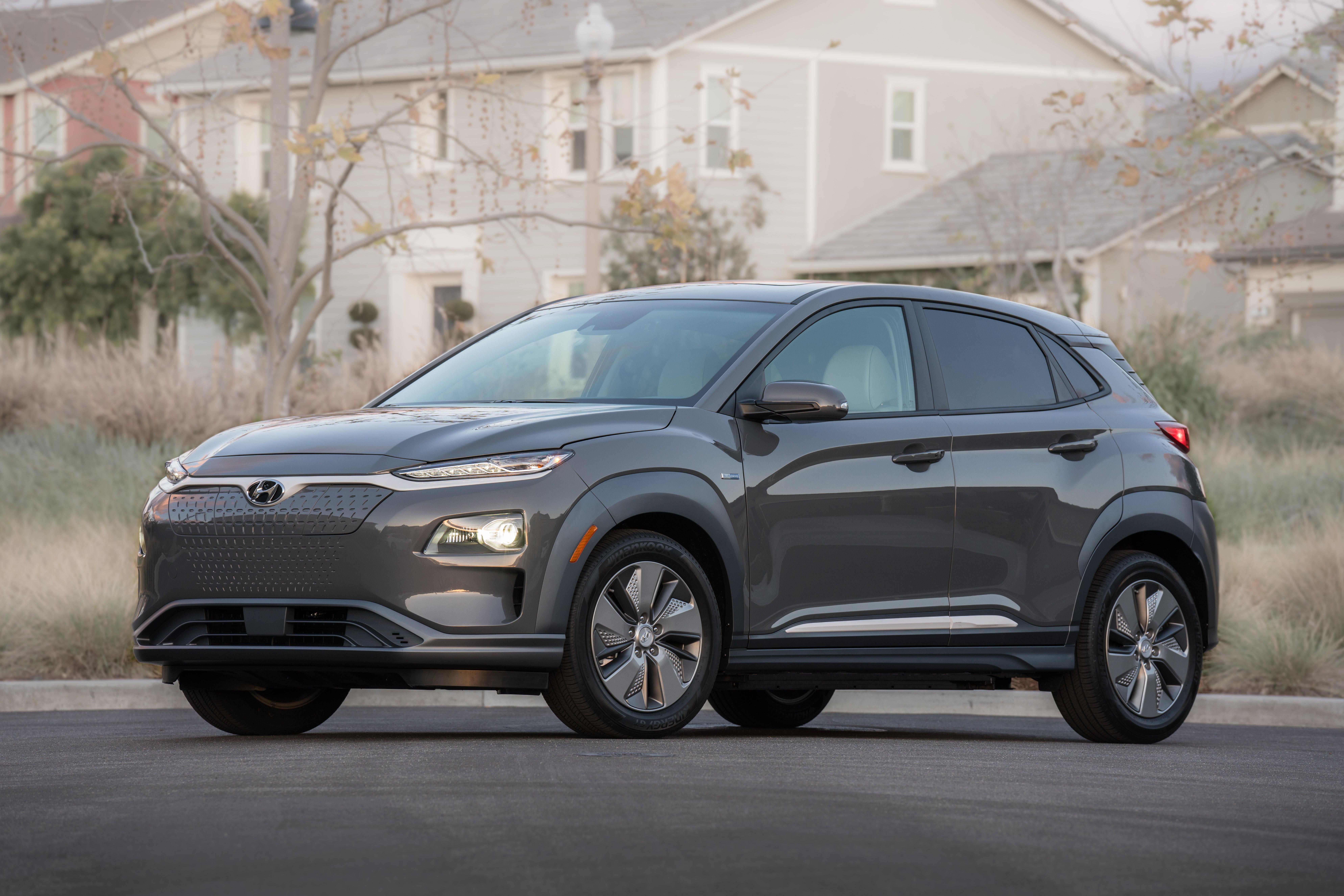 A gray 2019 Hyundai Kona Electric, a compact crossover SUV.