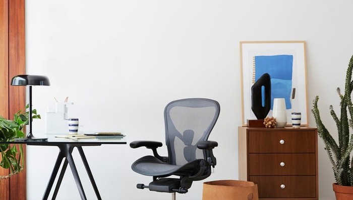 Herman Miller Aeron chair in retro office setting.