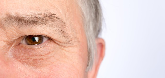 A close-up of a man's face, focused on one of his eyes.