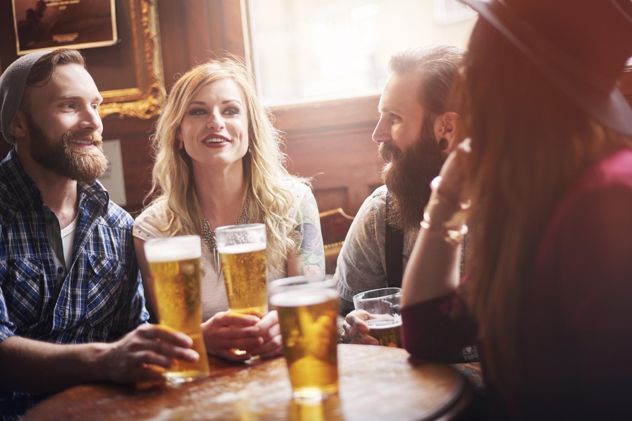 Friends having a beer at a bar.