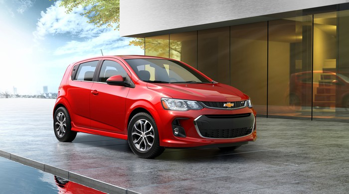 A red 2017 Chevrolet Sonic, a small hatchback