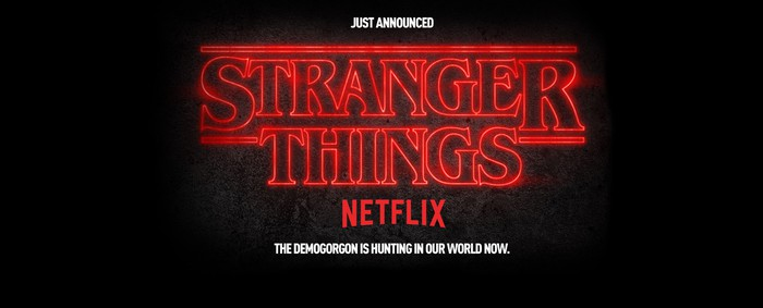 """Sign reads """"Just announced. Stranger Things. Netflix. The Demogorgan in hunting in our world now."""""""