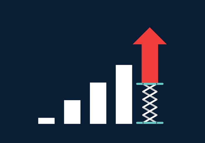 A column chart showing growth with the last column represented by a red arrow pointing upward and sitting on a springboard.