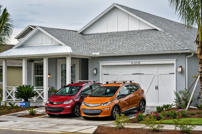 Two Bolt vehicles sitting in a driveway