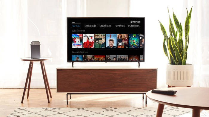 A TV in living room displaying Comcast Xfinity platform.
