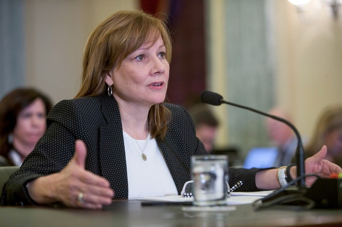 GM CEO Mary Barra is shown seated at a table in a U.S. Senate conference chamber.