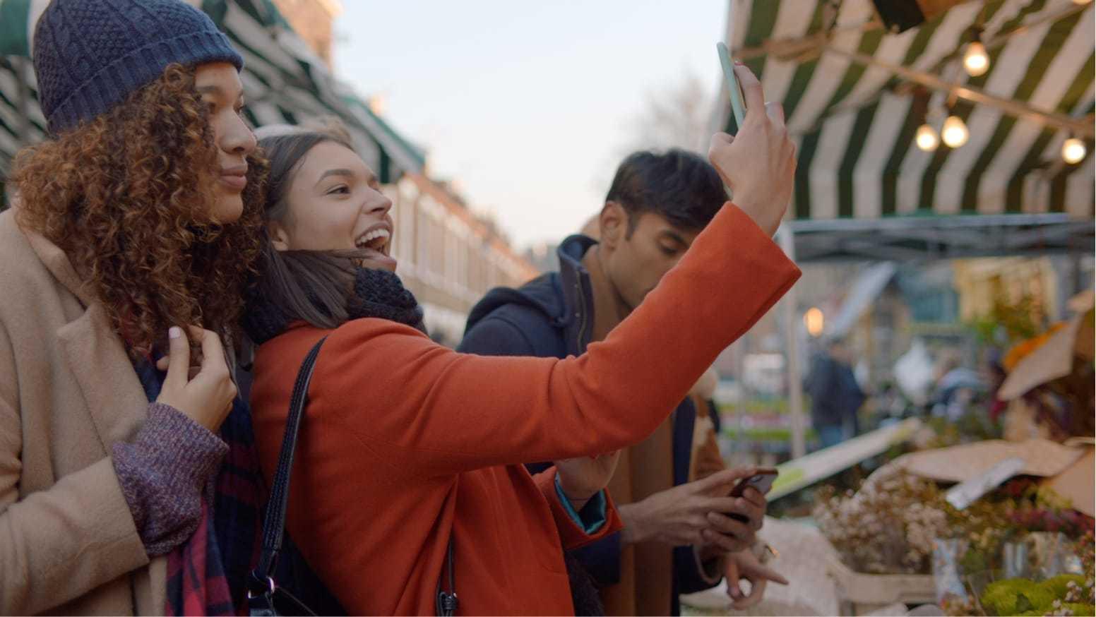 Women taking a selfie.