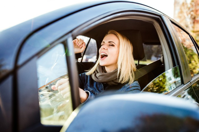 Woman singing in a car