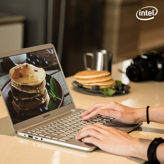 Person working on a laptop featuring a photo of a stack of pancakes
