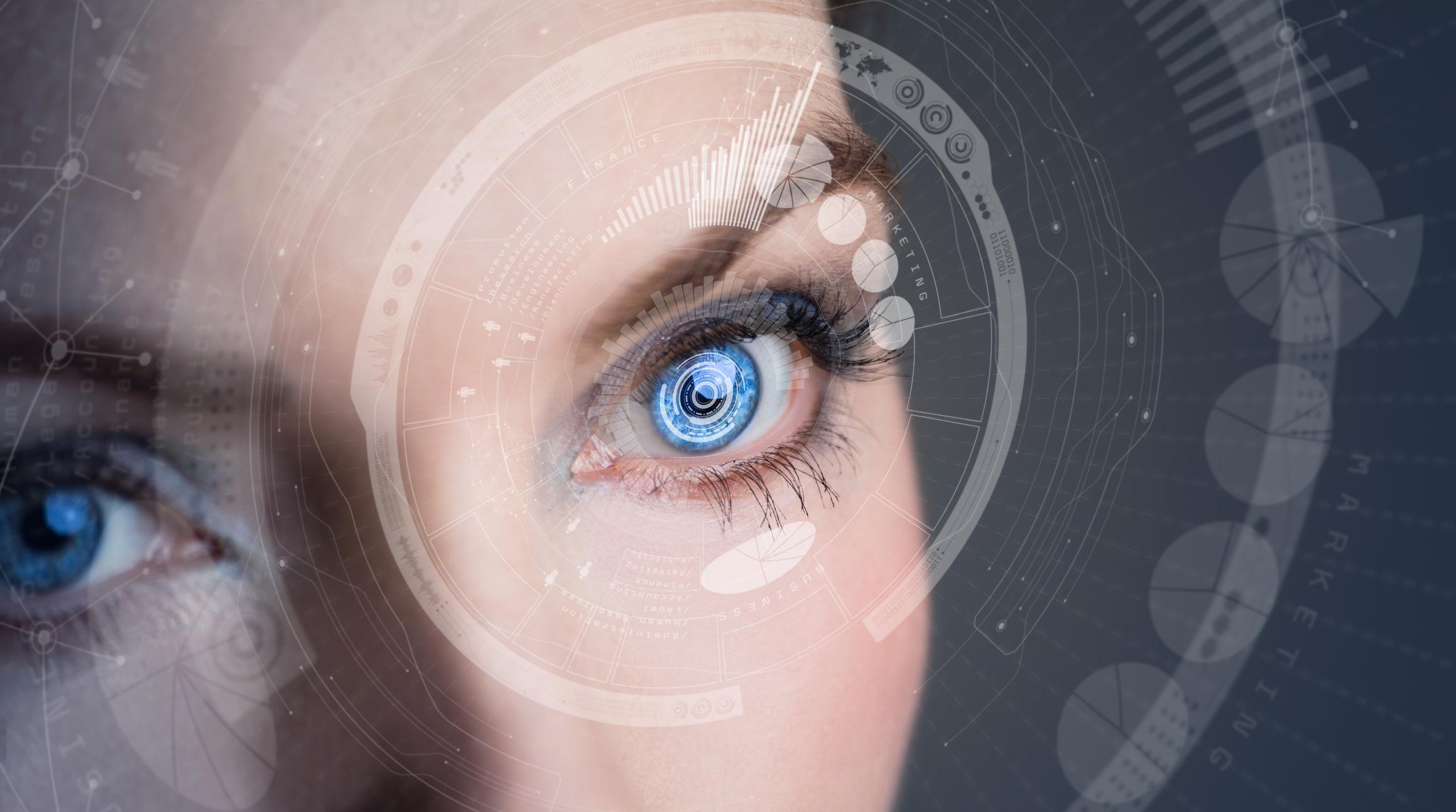 A woman wears a smart contact lens.