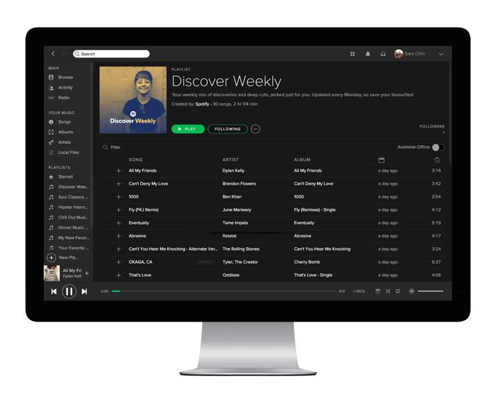 a desktop shows a Spotify playlist.