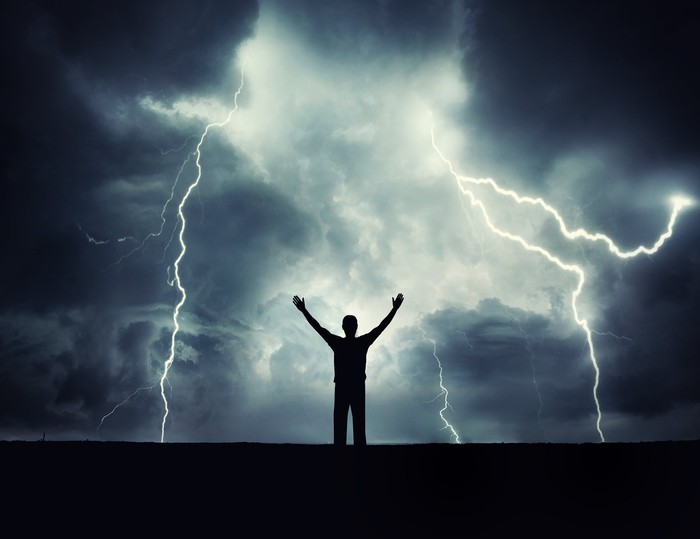 A man's silhouette on a storm background.