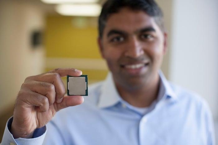An Intel executive holding a processor.