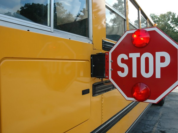 Stop Sign on a Yellow School Bus -- GettyImages-139681496
