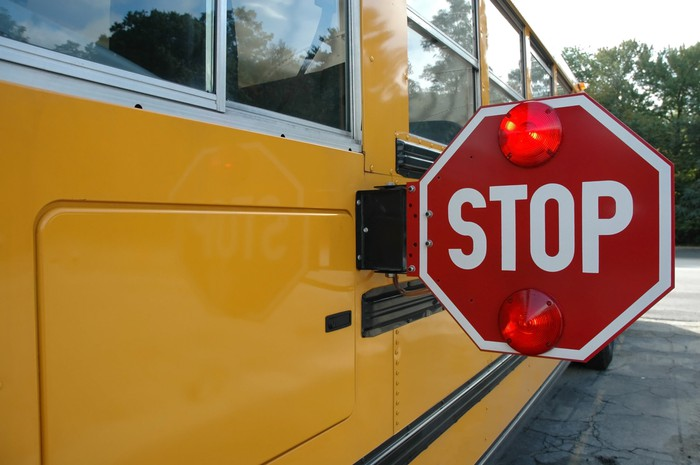 Stop sign on a yellow school bus