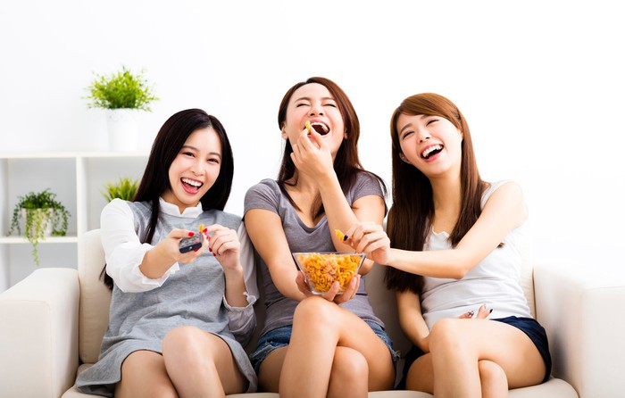 Three women watch TV.