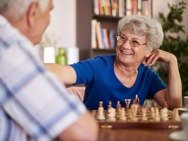 senior couple playing chess_GettyImages-486374500