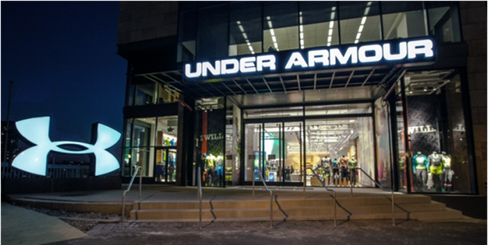 The entrance to an Under Armour store, with Under Armour on the marquee above the door and the company logo in the foreground.