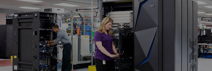 Woman working at an IBM Z mainframe.