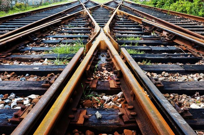 A closeup view of railroad tracks converging.