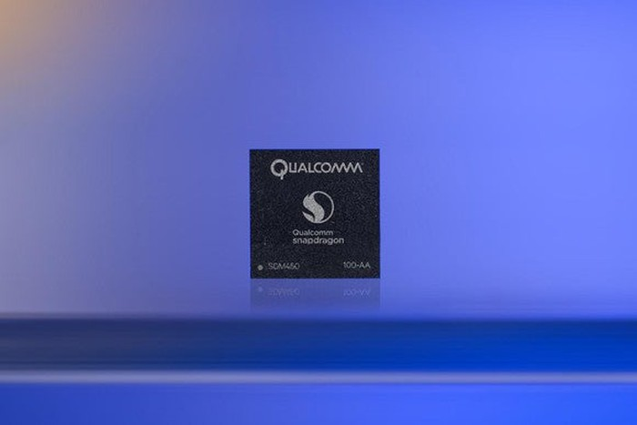A Qualcomm Snapdragon processor with a purple backdrop.