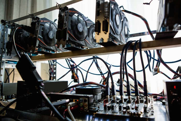 Hard drives and graphics processing units set up for cryptocurrency mining.
