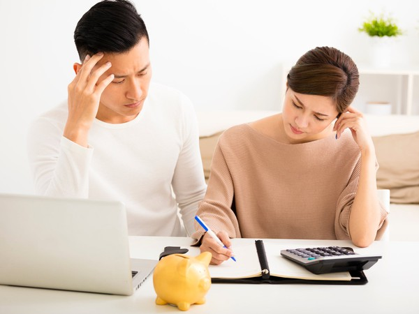 couple worried about bills_GettyImages-518458906