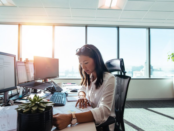 woman working at a desk_GettyImages-803690862