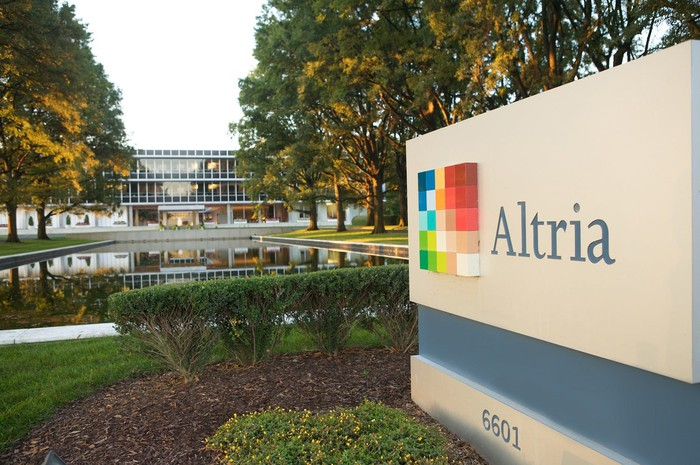 Altria headquarters with company logo on a sign in the foreground