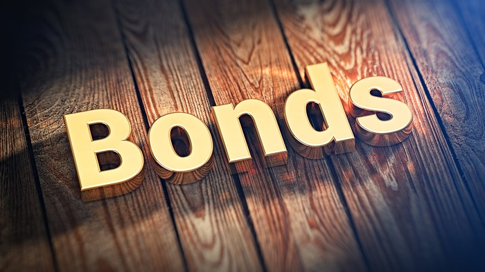 The word bonds in gold letters on wooden planks