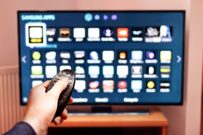 A man browses programs on a smart TV.