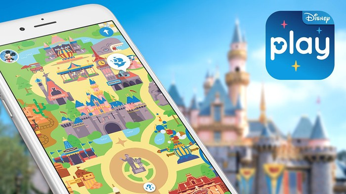 Play Disney Parks app with Disneyland's castle in the background.