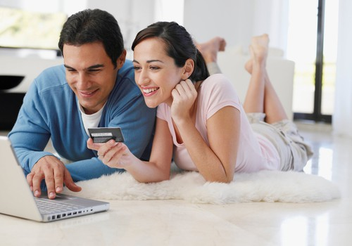 Couple shopping with credit card