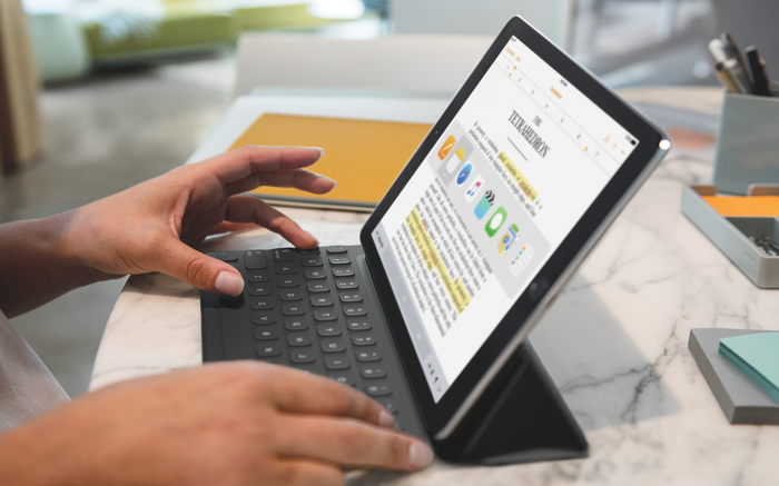 Person using iPad Pro and Smart Keyboard